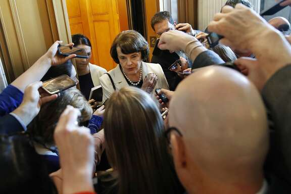 Sen. Dianne Feinstein, D-Calif., ranking member of the Senate Judiciary Committee, is asked questions by reporters about President Trump's decision to fire FBI Director James Comey, on Capitol Hill in Washington, Wednesday, May 10, 2017. (AP Photo/Jacquelyn Martin)