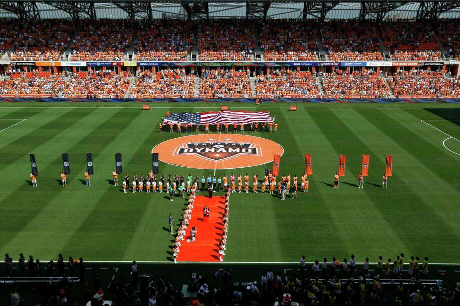 The National Anthem before the Houston Dynamo face the D.C. United in a MLS match during opening day at BBVA Compass Stadium Saturday, May 12, 2012, in Houston.