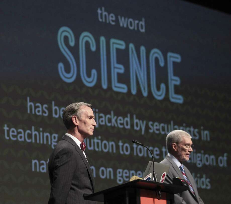 "Creation Museum head Ken Ham, right, speaks during a debate on evolution with TV's ""Science Guy"" Bill Nye. Photo: Matt Stone / Associated Press / The Courier-Journal"