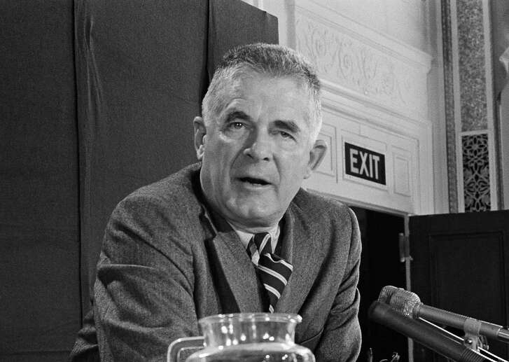 "FILE - In this Oct. 20, 1973 file photo, Archibald Cox speaks at a news conference in Washington. Comparisons to the Nixon-era ""Saturday night massacre"" were swift after President Donald Trump fired the acting attorney general for refusing to enforce his executive order on immigrants and refugees. In both cases, a dispute between a president and his Justice Department led to an evening maneuver by the president to install an acting attorney general more to his liking. (AP Photo/John Duricka, File)"