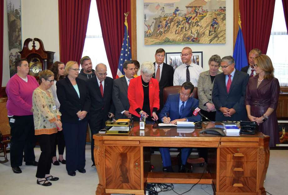 On Wednesday, May 10, 2017, Gov. Dannel P. Malloy signed into law legislation that will protect LGBTQ youth in the state from the destructive and discredited practice of conversion therapy, which in some cases has used electro-shock therapy. Photo: Contributed Photo / Contributed Photo / Connecticut Post Contributed