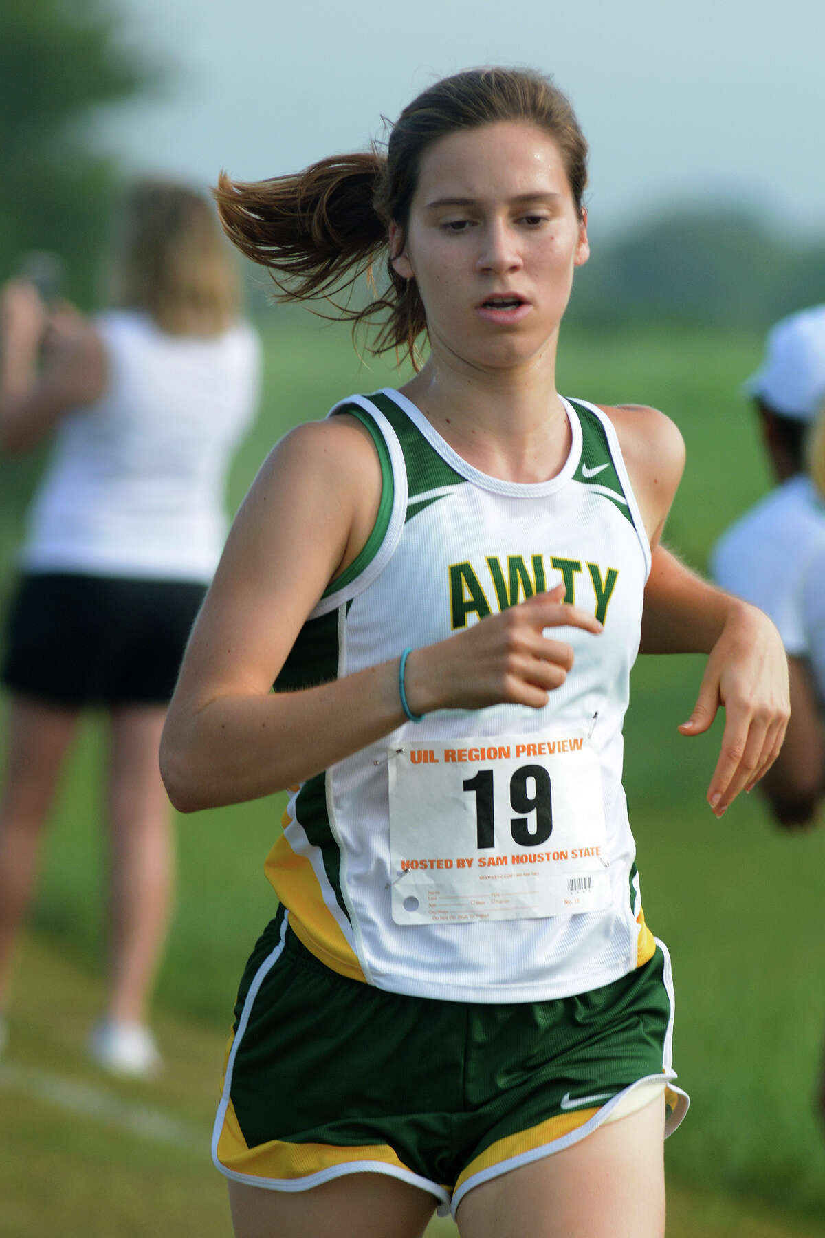 Awty International senior Carrie McIntyre (19) competes in the Varsity Girls Elite 5000 Meter race at the UIL Region III Cross Country Meet at Kate Barr-Ross Park in Huntsville on Sept. 10, 2016. (Photo by Jerry Baker/Freelance)