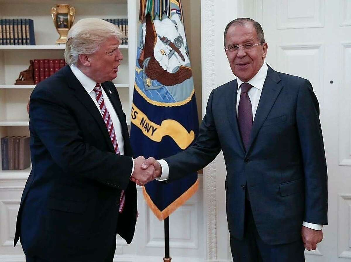 This handout photo released by the Russian Ministry of Foreign Affairs, shows President Donald Trump meeting with Russian Foreign Minister Sergey Lavrov in the Oval Office of the White House in Washington, Wednesday, May 10, 2017.