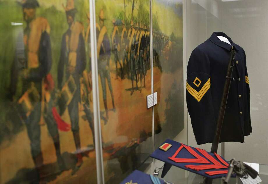Uniforms of soldiers in the U.S. Army have changed drastically since 1845 when Fort Sam Houston was built. Jacqueline Davis, curator of the Fort Sam Houston Museum gives a tour on Thursday, May 4, 2017. Photo: Bob Owen /San Antonio Express-News / ©2017 San Antonio Express-News