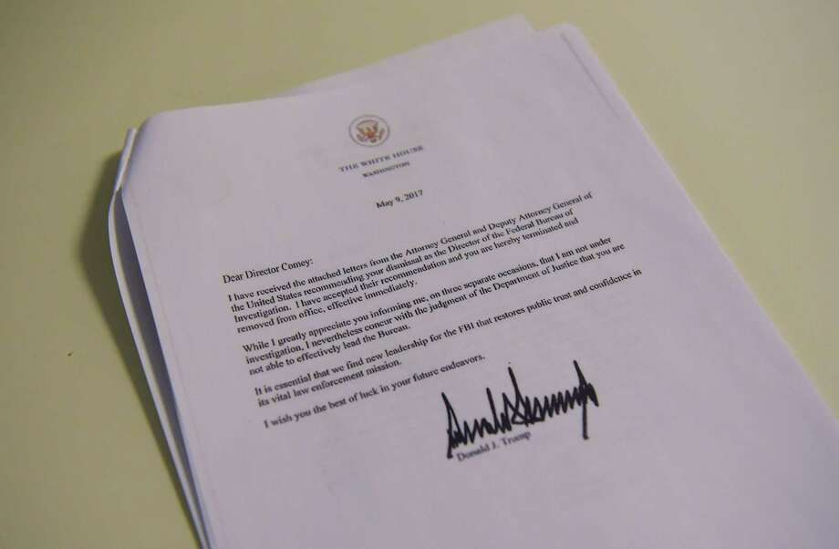 A copy of the termination letter to FBI Director James Comey from President Donald Trump is seen at the White House on May 9, 2017 in Washington. (Photo by Mandel Ngan/AFP/Getty Images) Photo: MANDEL NGAN, Staff / AFP or licensors