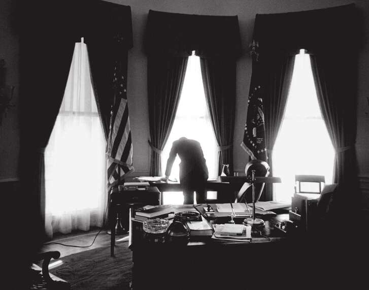President John F. Kennedy at work in the Oval Office, January 1961.