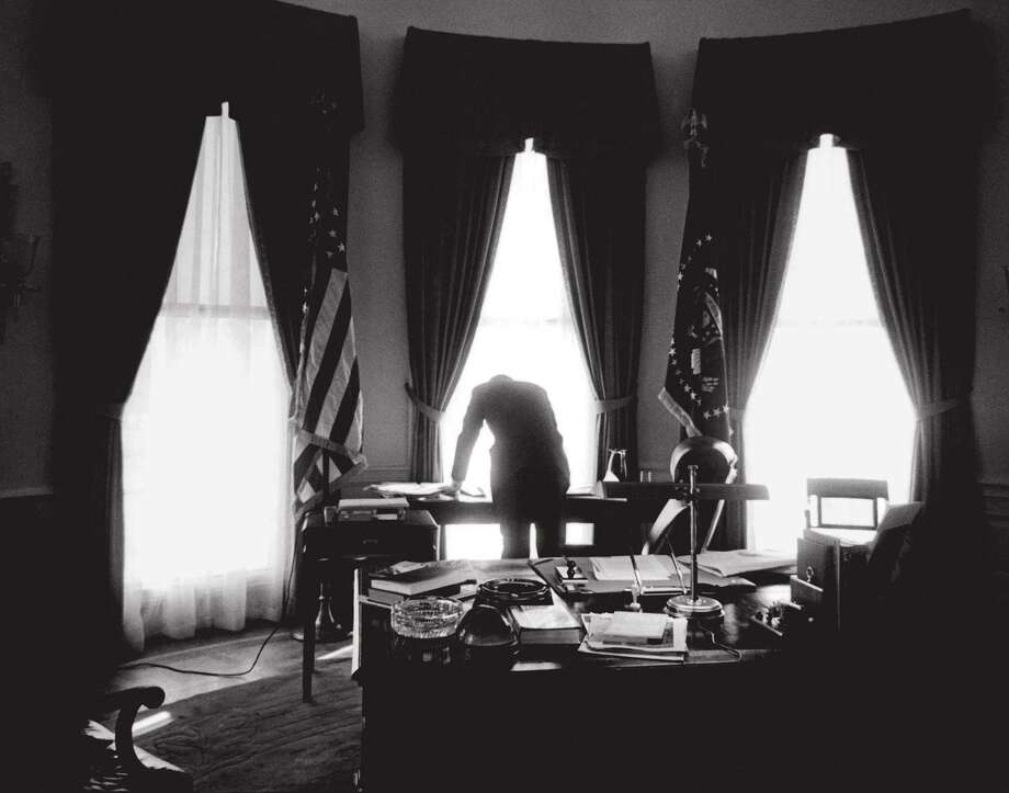 President John F. Kennedy at work in the Oval Office, January 1961. Photo: Jacques Lowe Estate / Smithsonian American Art Museum / CQ-Roll Call