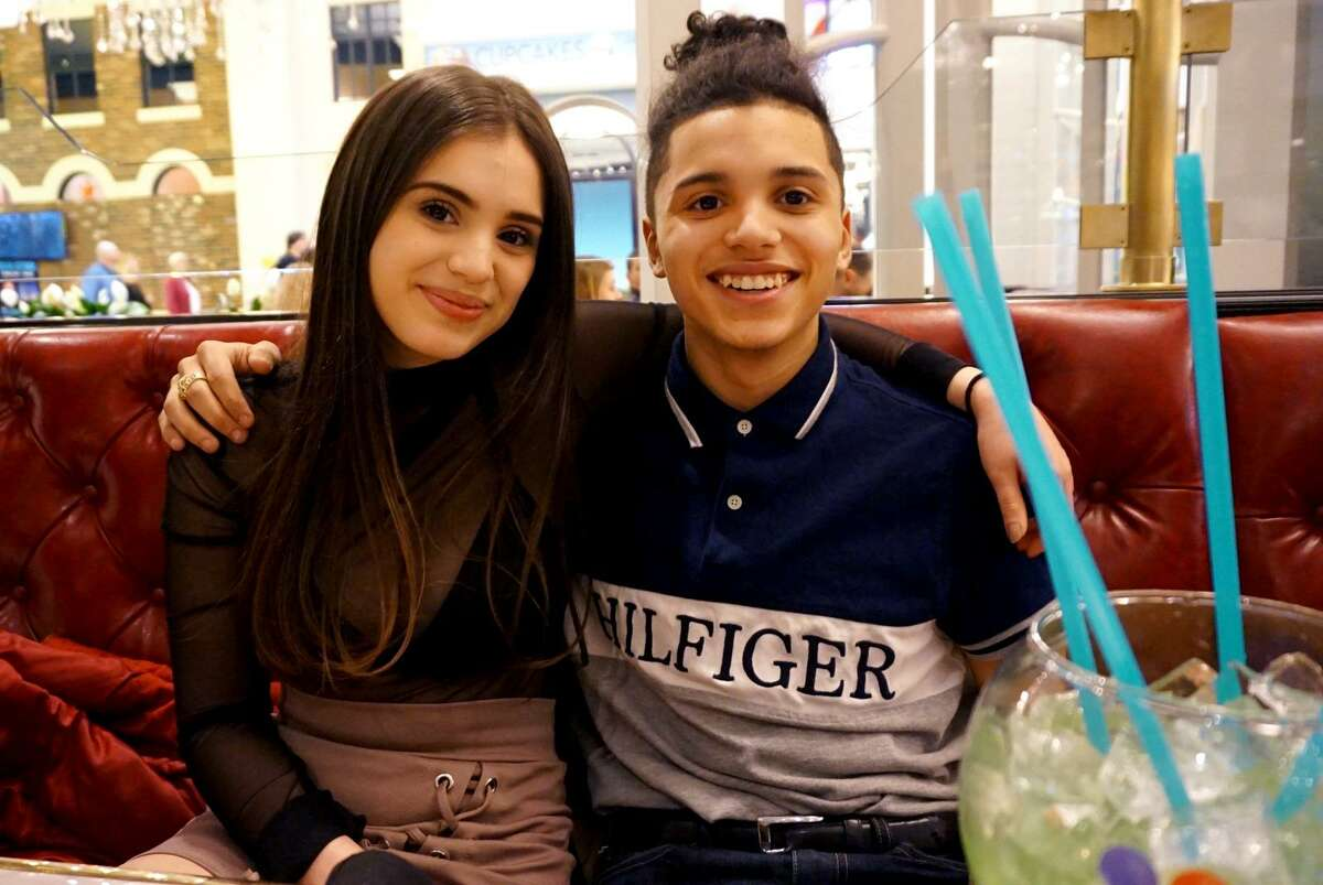 15-year-old Jayson Negron, left, celebrates with his half-sister Jazmarie Melendez on her birthday this past March.