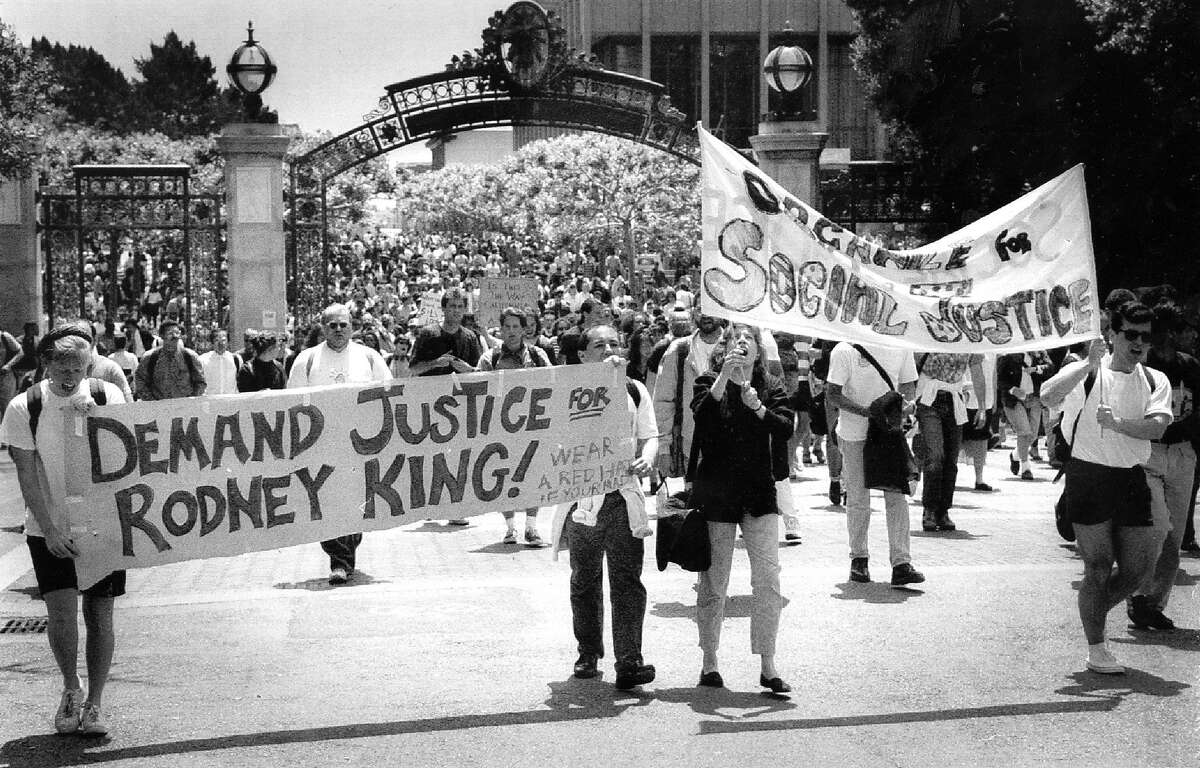 Cal students protesting the King verdict and making several other demands (as detailed in attached flyer) march from Sproul Plaza to California Hall. May 6, 1992.