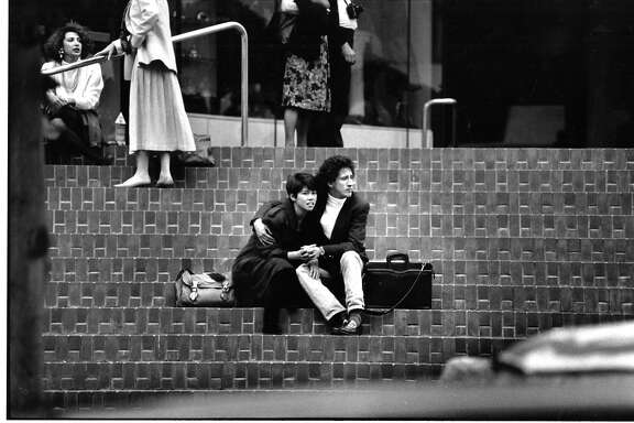 Moments after the 10/17/1989 earthquake, people sitting on the Hyatt Union Hotel square steps in downtown San Francisco