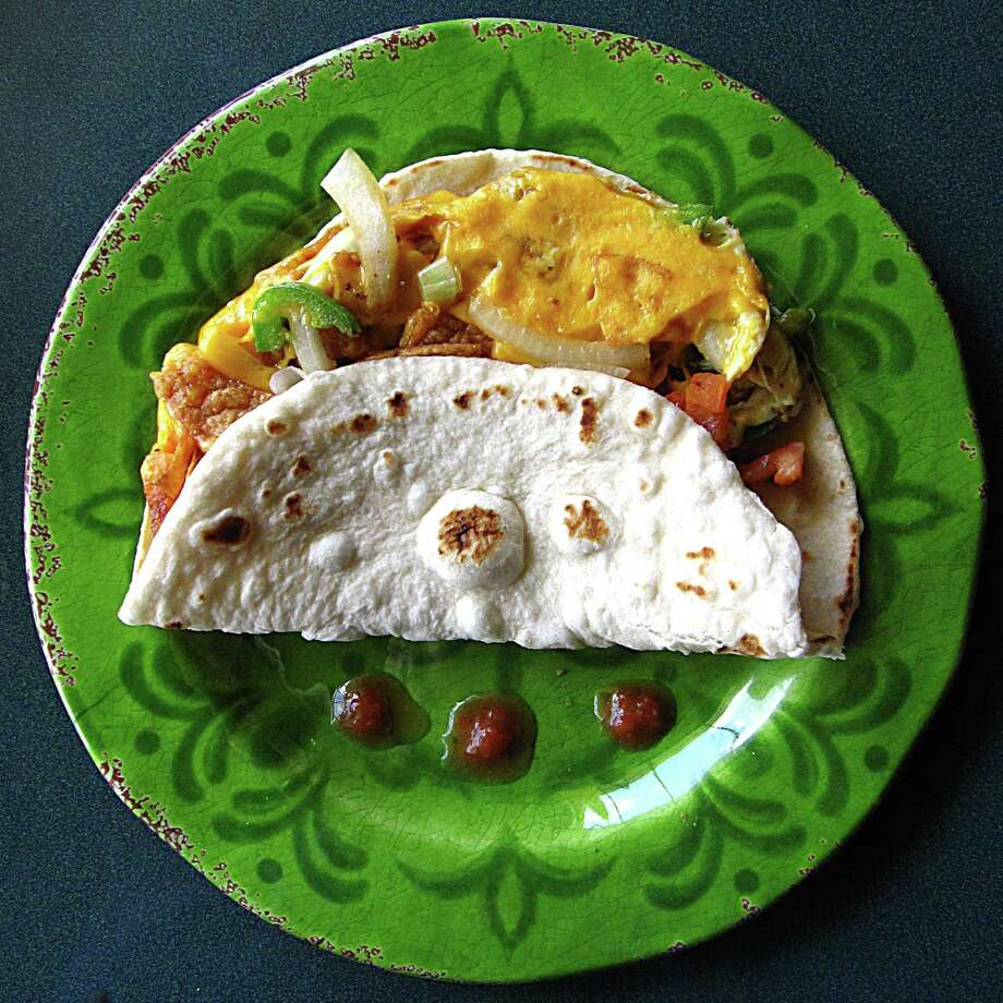 Chilaquiles taco on a handmade flour tortilla from Casa Chacon. Photo: Mike Sutter /San Antonio Express-News