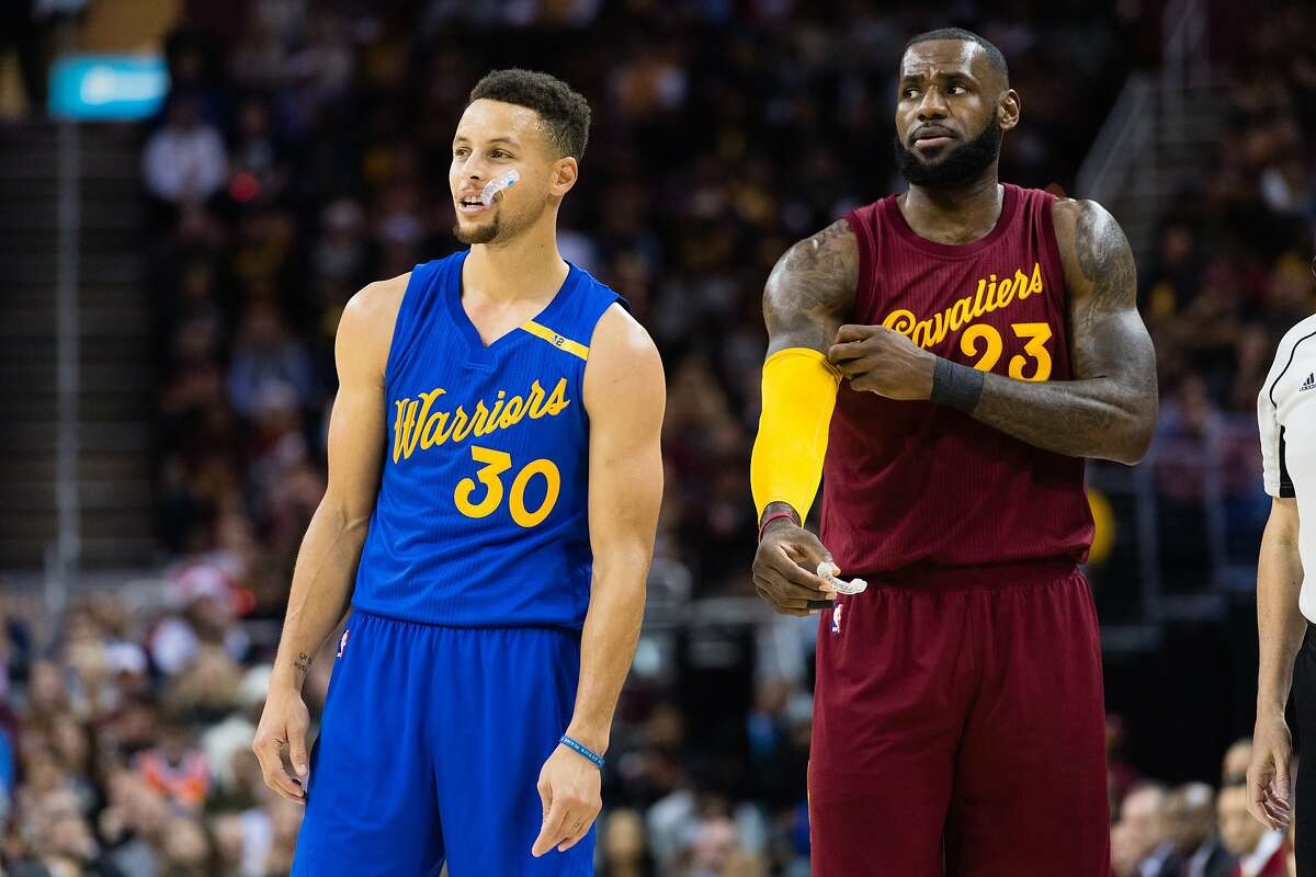CLEVELAND, OH - DECEMBER 25: Stephen Curry #30 of the Golden State Warriors and LeBron James #23 of the Cleveland Cavaliers pause on the court during the first half at Quicken Loans Arena on December 25, 2016 in Cleveland, Ohio.
