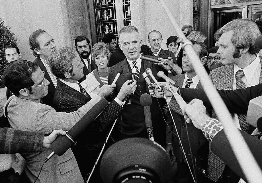 Special Watergate prosecutor Archibald Cox surrounded by reporters outside a federal court in Washington on Oct. 19, 1973, the day before Richard Nixon ordered him fired. Photo: John Duricka, AP