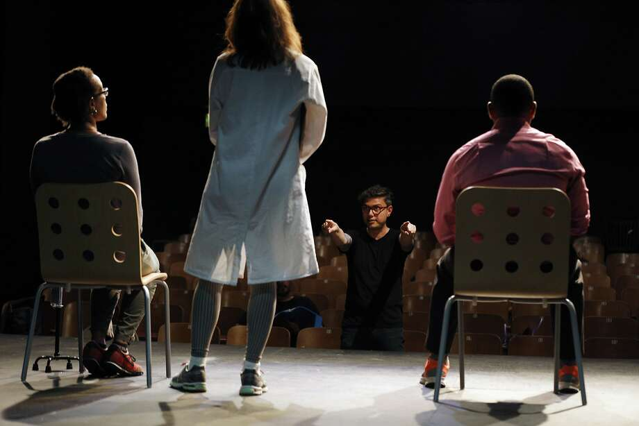 """Evren Odcikin, director of """"HeLa,"""" works with actors in rehearsal at the Live Oak Theater in Berkeley. Photo: Santiago Mejia, The Chronicle"""
