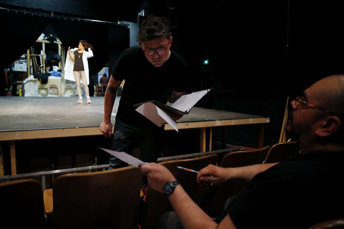 """Evren Odcikin checks the script at the Live Oak Theater on Wednesday, May 10, 2017, in Berkeley, Calif. Odcikin is the theatre director for """"HeLa,"""" presented by TheatreFirst."""