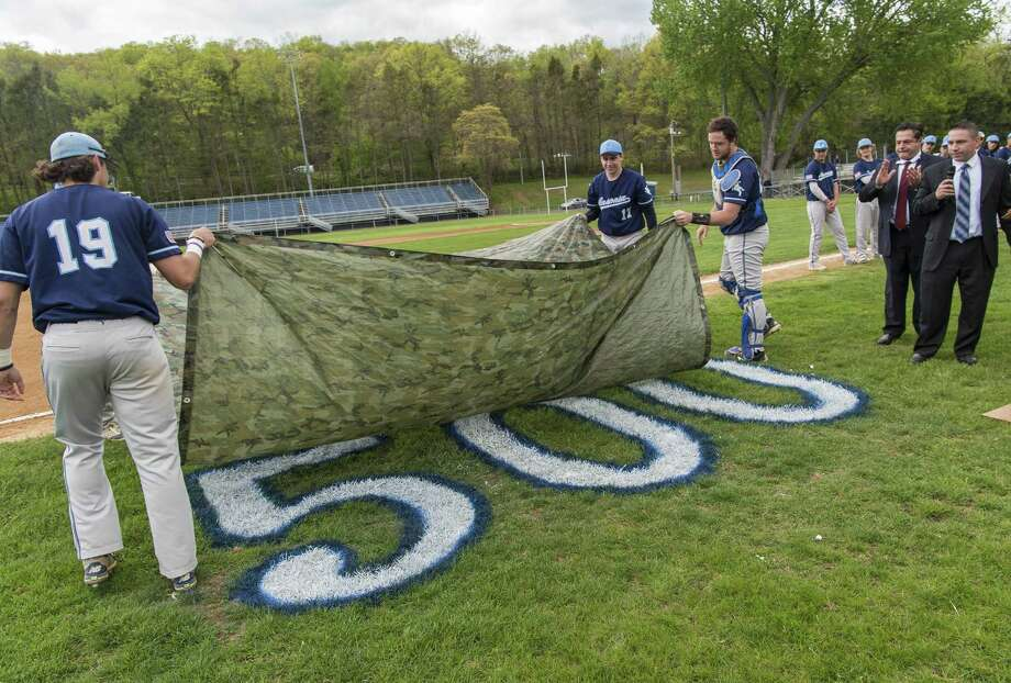 Above, Ansonia High School baseball players Bryson Cafaro, John Bucci, and Patrick Palmer unveil the number 500 painted on the field to honor head coach Mike Vacca winning his 500th game this week. The ceremony was held prior to a game against Oxford High School played at Nolan Field, Ansonia, CT. Wednesday May 10, 2017. Photo: Mark Conrad / For Hearst Connecticut Media / Connecticut Post Freelance