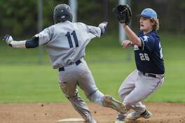 Ansonia High School's Trent Mankulics gets the ball in time to tag out Oxford High School's Jason DeNigris at second base during a baseball game played at Nolan Field, Ansonia, CT. Wednesday May 10, 2017.