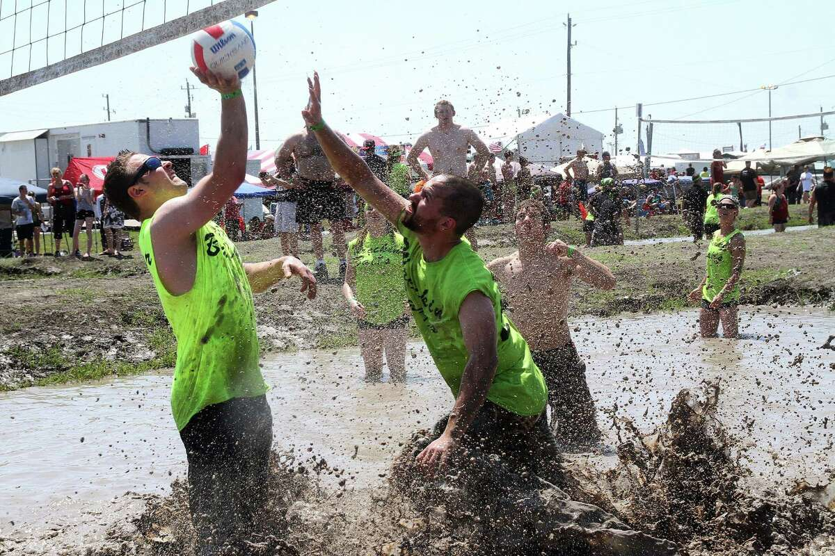 Competition can get fierce in the mud volleyball tournament at the Pasadena Strawberry Festival.