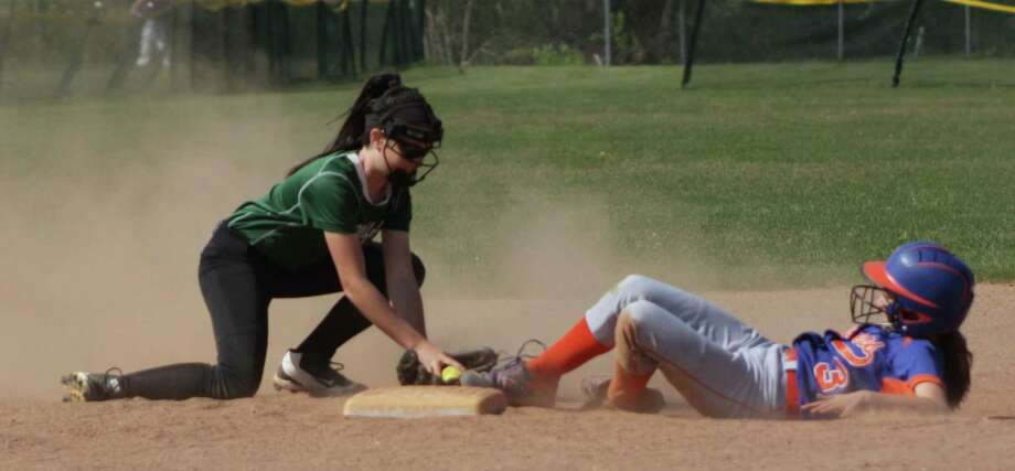 A Danbury High School runner tries to seal second, but New Milford High School second baseman Paige Duffany gets the out in the bottom of the second. Photo: Courtesy Of Katie Alzapiedi / The News-Times Contributed