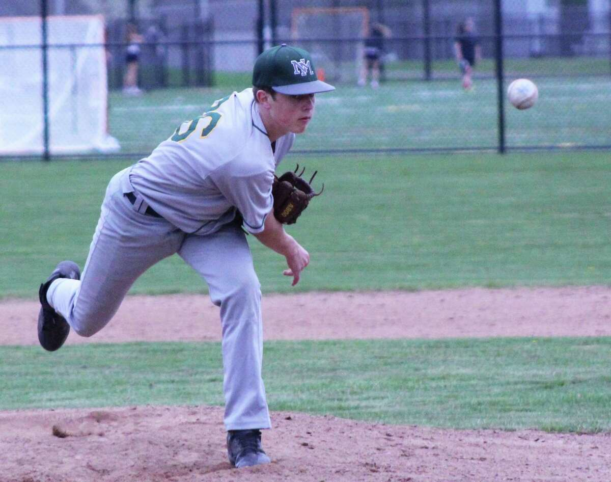 The New Milford High School freshmen baseball team recently faced Joel Barlow. The Green Wave won the April 24 game 7-6, making the team undefeated 7-0 for the season. Above, Joey Larson throws a curve ball over the plate to strike out the Joel Barlow opponent.