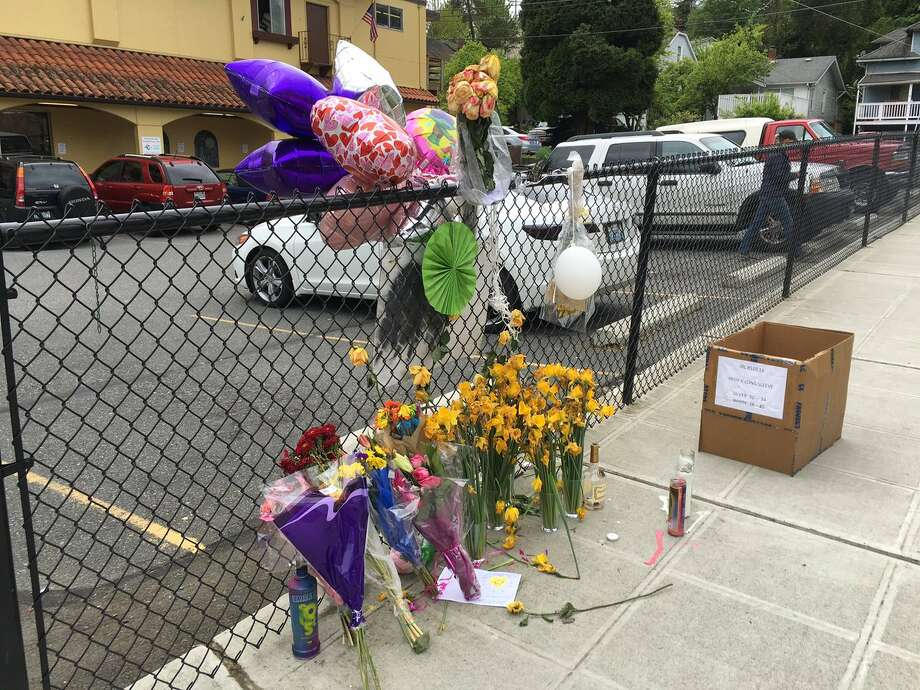A teen girl shot dead outside a Seattle bakery has been identified as 16-year-old Kahlani Shabazz. A memorial took shape at the corner where she was killed in the days after her shooting. Photo: Kara Kostanich / KOMO News