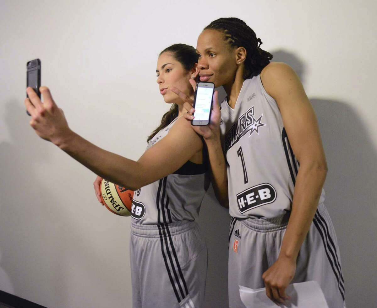 Monique Currie (right) and Kelsey Plum take selfies during the Stars' media day at San Antonio Stars players Monique Currie, right, and Kelsey Plum take selfie pictures during media day on Wednesday, May 10, 2017.