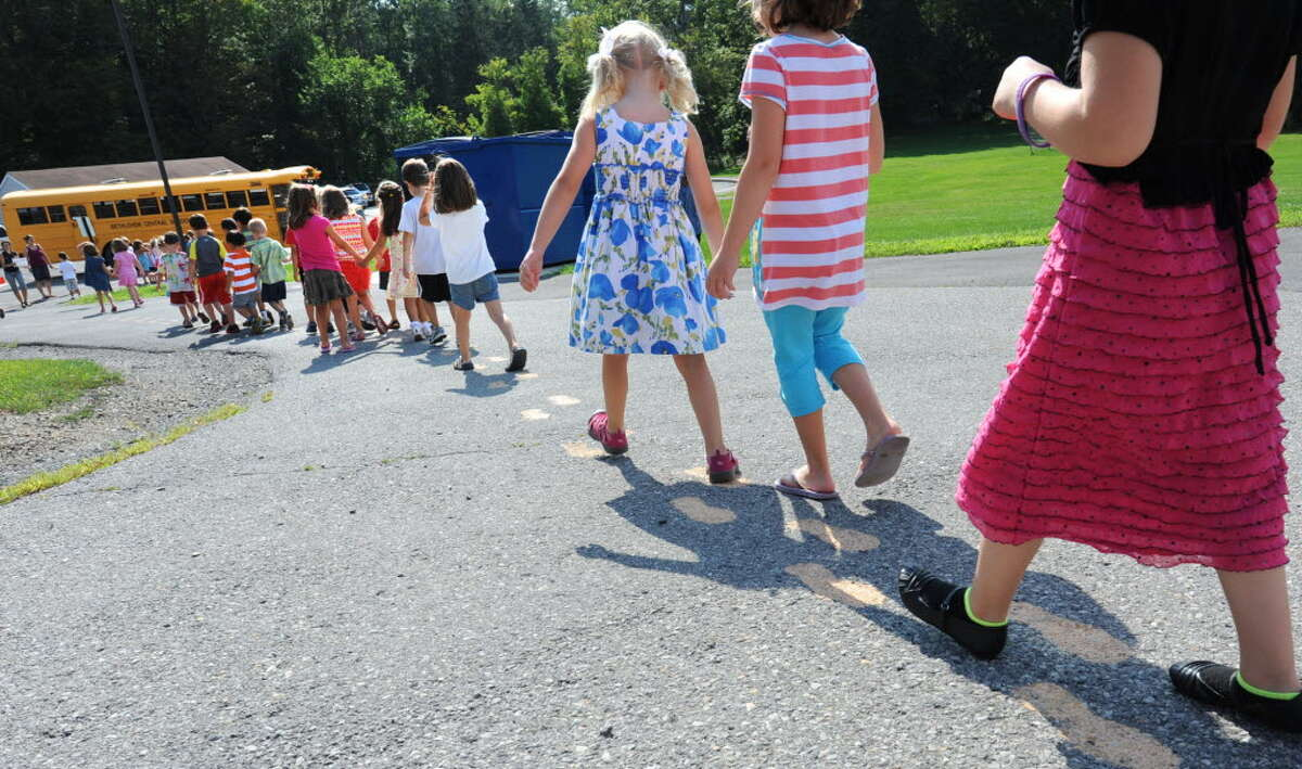 Students head out to the buses while attending bus orientation at Slingerlands Elementary School Tuesday, Aug. 28, 2012 in Delmar, N.Y. (Lori Van Buren / Times Union)