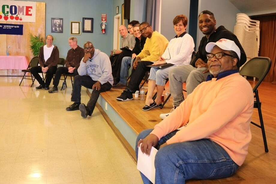"Cast members from ""The Exonerated"" rehearse at the First Congregational Church on Quail Street in Albany. The play will be presented May 19-21 at the church by the nonprofit Soul Rebel Performance Troupe. (Submitted photo)"