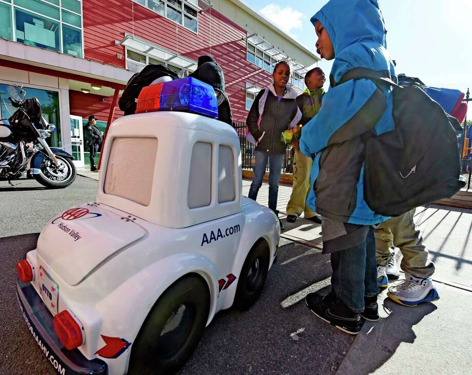 Students at the Delaware Community School are entertained by Otto the Auto from AAA on Bike to School Day May 10, 2017 in Albany, N.Y.    (Skip Dickstein/Times Union) Photo: SKIP DICKSTEIN / 20040465A
