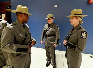 Local Troopers Curtis Rick, left, Joseph Turoski, center and Meghan Lohman chat before receiving their diplomas at the 205th session graduation of Basic School of the New York State Police held at the Empire Plaza Convention Center May 10, 2017 in Albany, N.Y.  (Skip Dickstein/Times Union)