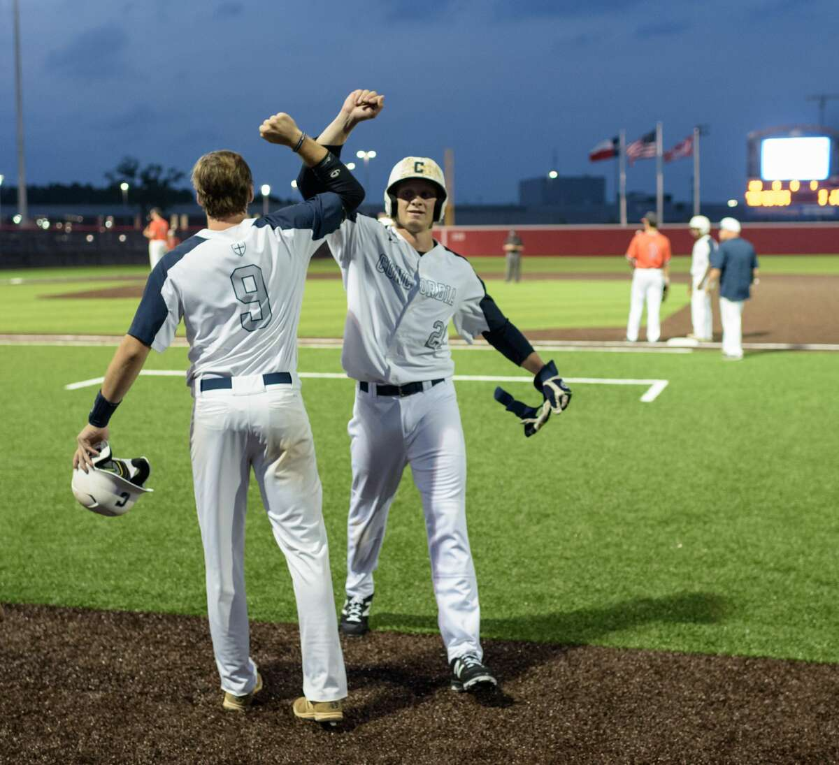Shane Baz (21) of the Concordia Lutheran Crusaders is congratulated by Terrence Spurlin (9) for his base hit against the St. Pius X Panthers in a TAPPS baseball playoff game on Wednesday, May 10, 2017 at the Crosby High School Baseball Field in Crosby, Texas.