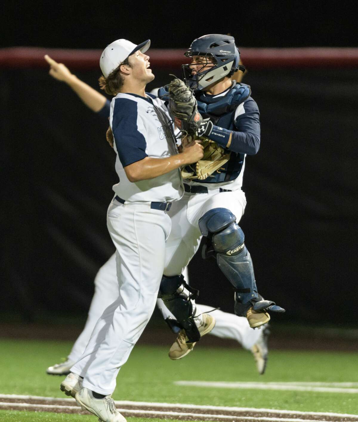 Caleb Black (18) of the Concordia Lutheran Crusaders chest bumps catcher, Hunter McQuary (3) after defeating the St. Pius X Panthers 8-2 in a TAPPS baseball playoff game on Wednesday, May 10, 2017 at the Crosby High School Baseball Field in Crosby, Texas.