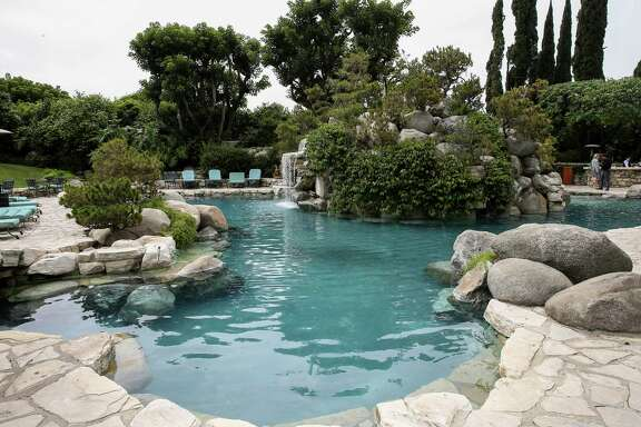 The Playboy Mansion in Los Angeles, which features 29 rooms, was among the priciest homes to sell in 2016. Global luxury home sales cooled off last year for the second year in a row, even as a record number of homes sold for more than $100 million, a report shows. Below is an area of the grounds at the Playboy Mansion.