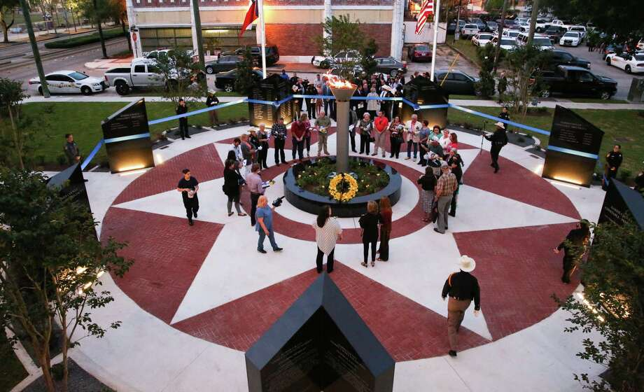 Families of  the fallen Peace Officers of Harris County gather at the newly constructed Memorial Garden in tribute to their loved ones for the ribbon cutting ceremony at Crime Stoppers Dave Ward building Wednesday, May 10, in Houston. Photo: Yi-Chin Lee / Houston Chronicle, Yi-Chin Lee / Houston Chronicle 2017