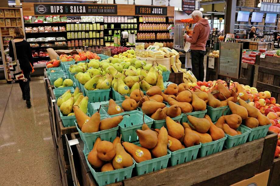Fresh fruit is displayed in a Whole Foods Market grocery store. The Austin-based company shuffled its leadership on Wednesday. Photo: Gene J. Puskar, STF / Copyright 2017 The Associated Press. All rights reserved.