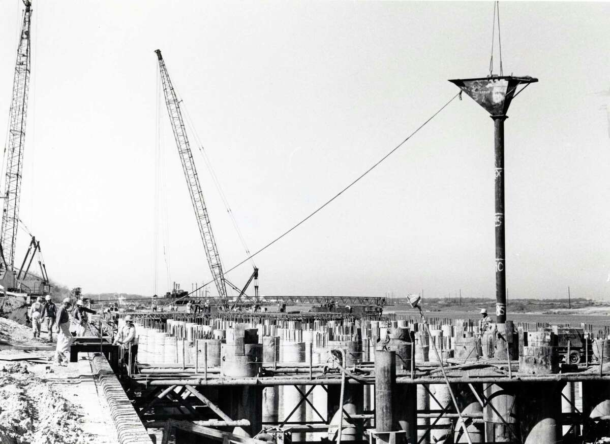 In March 1976, workers poured concrete into footing forms as work progressed on the container terminal.