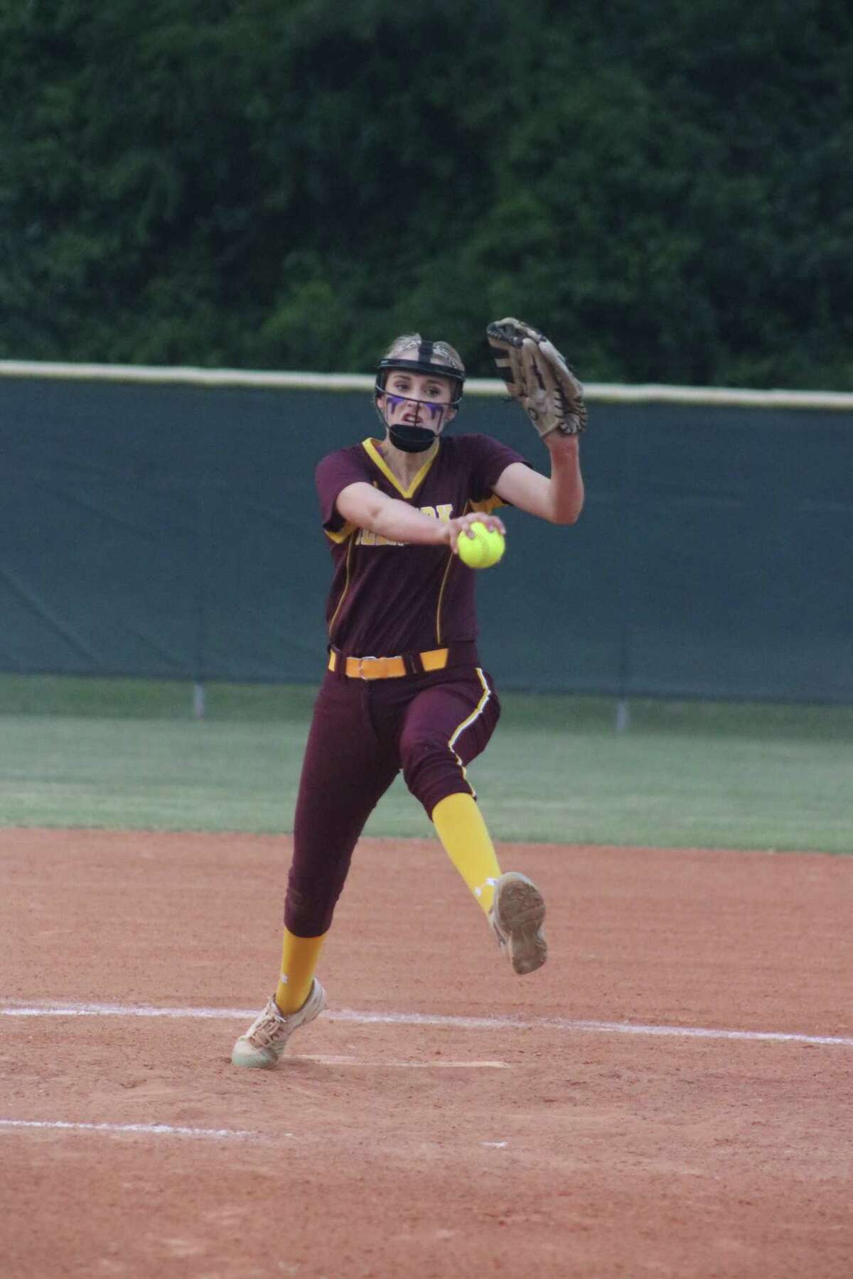 Deer Park pitcher Maddie Nelson goes through her windup during first-inning action Wednesday night. Nelson finished with a four-hitter.