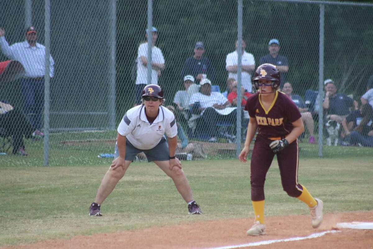 With head coach Carrie Austgen manning the third-base box, Alyssa Hernandez takes a few steps off the bag as Deer Park attempts to cash in on an early uprising Wednesday night.