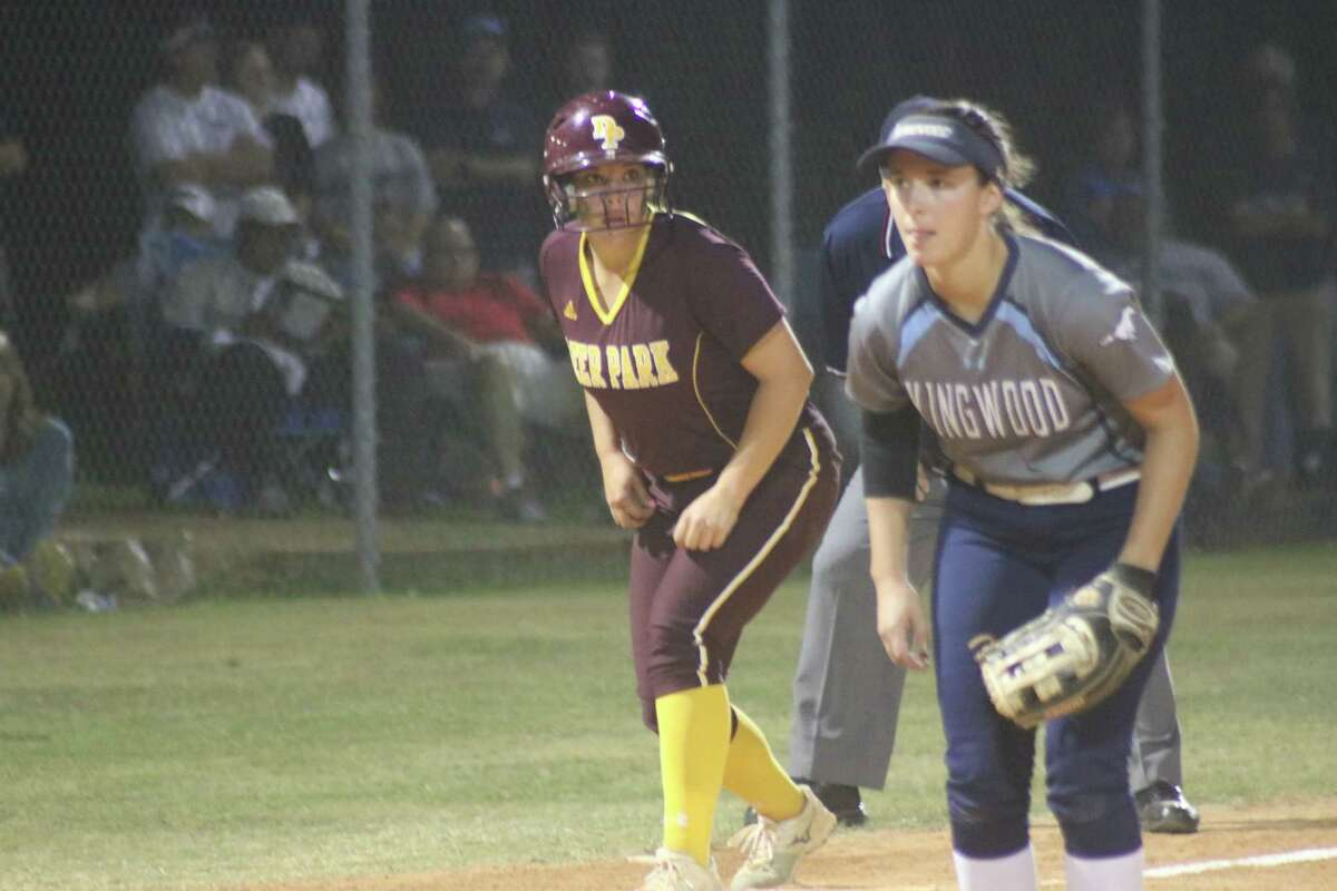 Deer Park's potential tying run waits for the result of the next pitch during the team's rally in the sixth inning Wednesday night. The Kingwood third baseman is Amanda Cleaver.