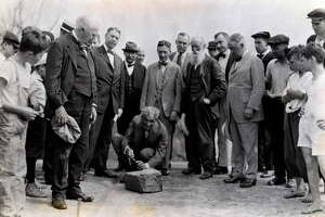 Henry Ford, center,  carves his name into a cornerstone of a Ford plant in Green Island with Thomas Edison, left holding hat, Albany mayor James R. Watt, third from left, Harvey Firestone, third from right, John Burroughs, second from right with beard, and Troy Mayor Cornelius Burns, right, Aug. 5, 1919, in Green Island, N.Y. Historic (Times Union archive)