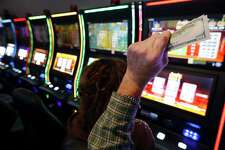 """With money in hand, Lufkin resident Tom Hudgens and his friend Jody Carrington play on a gaming machine at Naskila Entertainment in Livingston, Texas on Tuesday, June 7, 2016. Hudgens claimed he started with $20 and cashed out three times for winnings totalling a couple thousand dollars. The Alabama Coushatta Indian Tribe in Livingston - about an hour north of Houston - reopened its casino after a 14-year closure prompted by threats from the state of Texas to take legal action against the tribe. Recent legal developments paved the way for the reopening. With 365 Class 2 electronic gaming devices, the former casino has been renamed Naskila Entertainment and its doors opened earlier this month to eager guests and gamers. Only """"bingo"""" type machines are in use at Naskila Entertainment according to officials. (Kin Man Hui/San Antonio Express-News)"""