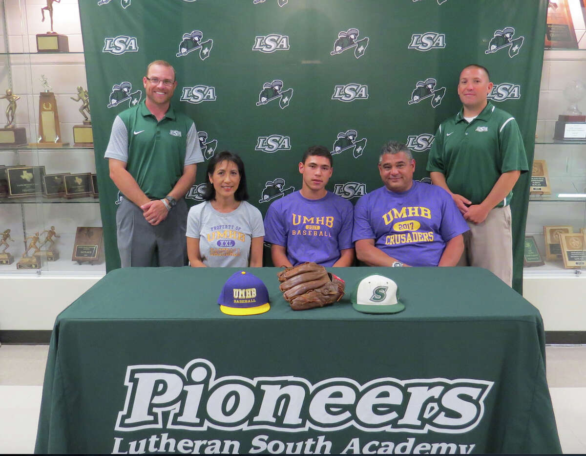 Jake Thomas of Lutheran South Academy has signed a baseball letter of intent with Mary Hardin-Baylor. Shown with Thomas are his parents, Andrew and Joann, along with LSA baseball coaches Aaron Schneider (back left) and A.J. Betcher.
