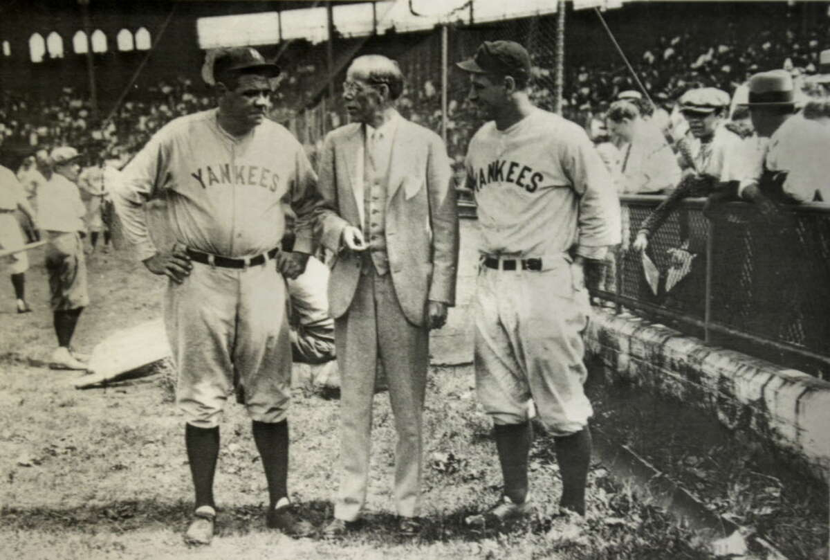 Times Union staff photo by Paul Buckowski --- A copy of an old photograph taken in August of 1929 of Babe Ruth, left, Albany Mayor John Boyd Thacher, center, and Lou Gehrig. The photo was taken when the Yankees came to Albany to play an exhibition game. It was at that game that Fred Miggans was a bat boy. In the far left background of the photo is a bat boy but Miggans said that he was not sure if that was him or another boy that was there.