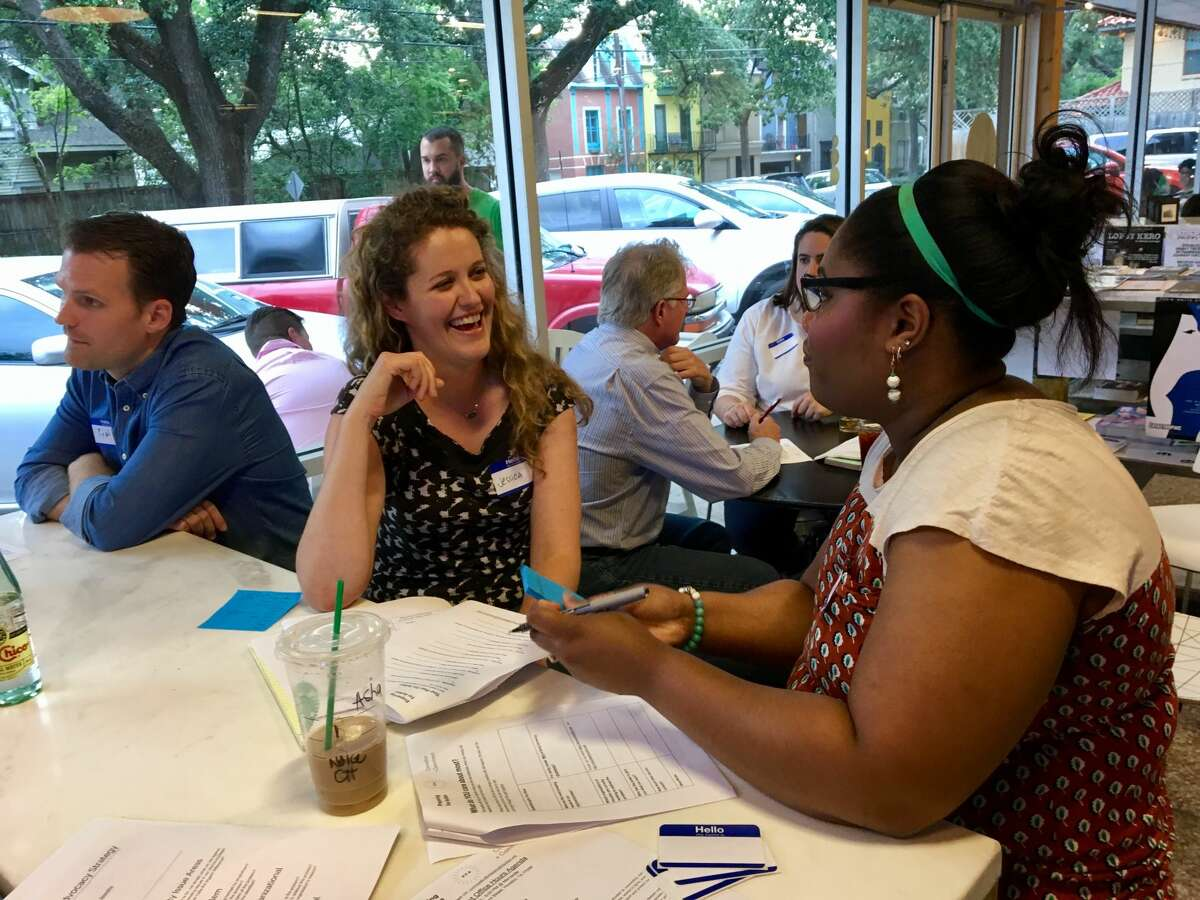 Jessica Wilbanks (center) talks with one of the participants at Activist Office Hours, organized by a group of Houston-based political activists called Preparing for Action.