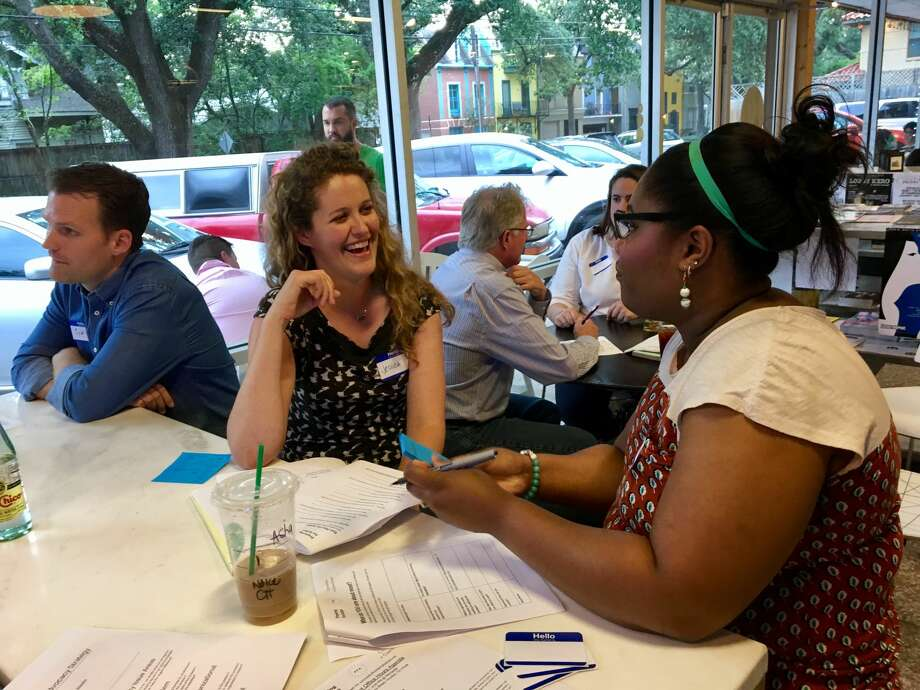 Jessica Wilbanks (center) talks with one of the participants at Activist Office Hours, organized by a group of Houston-based political activists called Preparing for Action. Photo: Melanie Espinosa Pang