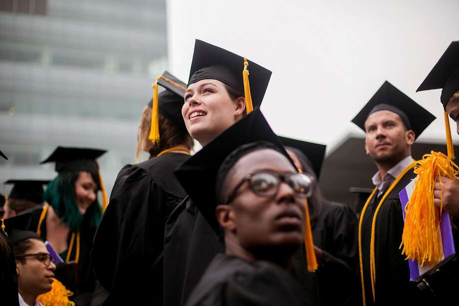 City College of New York students celebrate at their graduation ceremony last year. Some student debts all over the country might be wiped out because of missing paperwork. Photo: SAM HODGSON, NYT