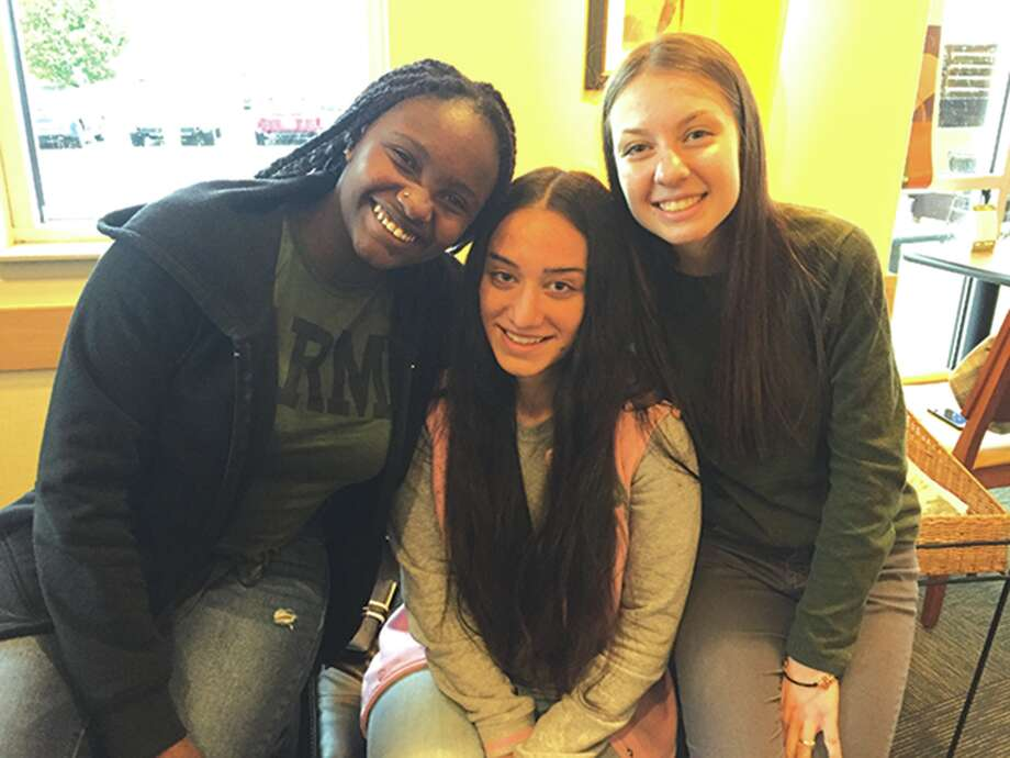 Exchange students attending EHS are, from left: Nicole Anainga from Kenya, Julia Tsertsvadze from Georgia and Mirela Minkova from Bulgaria. Photo: Julia Biggs • Intelligencer