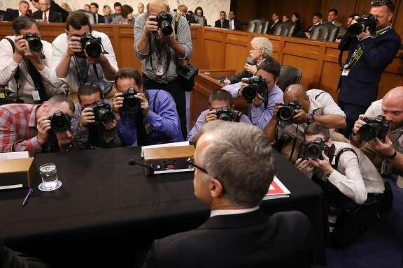 WASHINGTON, DC - MAY 11:  Photographers focus on acting FBI Director Andrew McCabe as he prepares to testifiy with the other heads of the United States intelligence agencies before the Senate Intelligence Committee in the Hart Senate Office Building on Capitol Hill May 11, 2017 in Washington, DC. McCabe was testifying in place of former FBI Director James Comey, who was fired by President Donald Trump on Tuesday.  (Photo by Chip Somodevilla/Getty Images)