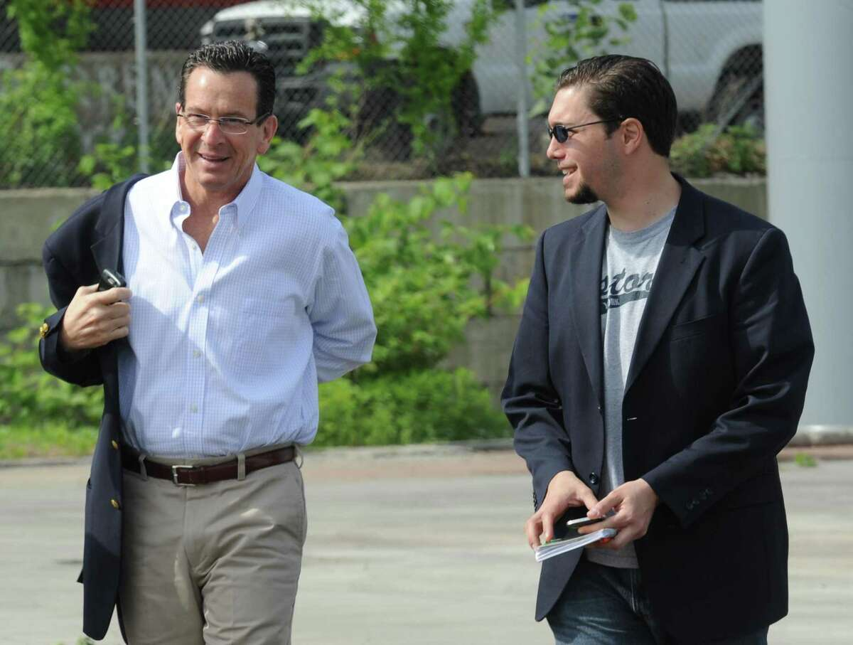 Gov. Dannel Malloy and former Malloy spokesman Andrew Doba near the scene of Metro-North train collision in Bridgeport, Conn. in 2013. Doba and Malloy?'s longtime political adviser Roy Occhiogrosso are on opposite sides of the legislative and legal battle for a third casino planned for north of Hartford.