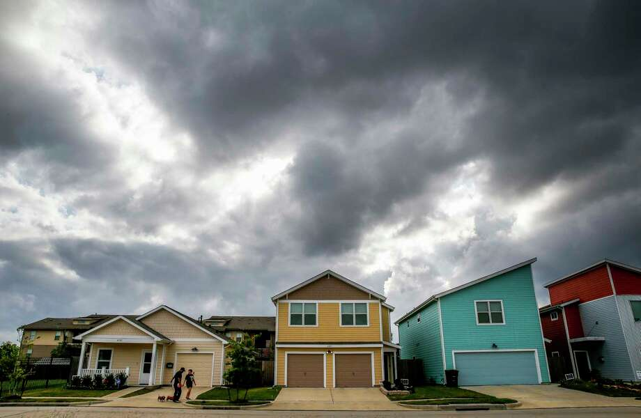 Michael and Diana Castillo walk their dogs around the Avenue Place affordable housing neighborhood Tuesday, April 25, 2017 in Houston. The city of Houston has wasted, misspent or lost track of tens of millions of affordable housing dollars over the last decade. Photo: Michael Ciaglo, Houston Chronicle / Michael Ciaglo